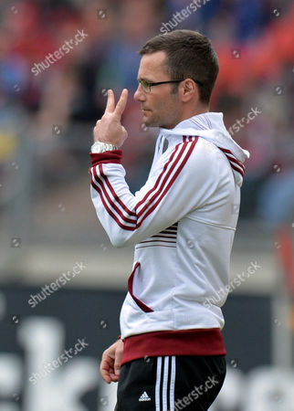 Nuremberg's Head Coach Michael Wiesinger Gestures During the Bundesliga Soccer Match Between 1 Fc Nuremberg and Bayer 04 Leverkusen Grundig-stadion in Nuremberg Germany 04 May 2013 (attention: Embargo Conditions! the Dfl Permits the Further Utilisation of Up to 15 Pictures Only (no Sequential Pictures Or Video-similar Series of Pictures Allowed) Via the Internet and Online Media During the Match (including Halftime) Taken From Inside the Stadium And/or Prior to the Start of the Match the Dfl Permits the Unrestricted Transmission of Digitised Recordings During the Match Exclusively For Internal Editorial Processing Only (e G Via Picture Databases) Germany Nürnberg