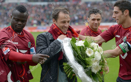 The Fans Say Farewell to Hanover's Steven Cherundolo (2-l) with Teammates Didier Ya Konan (l-r) Manuel Schmiedebach and Lars Stindl During the German Bundesliga Soccer Match Between Hannover 96 and Sc Freiburg at Hdi Arena in Hanover ágermany 10 May 2014 Germany Hanover