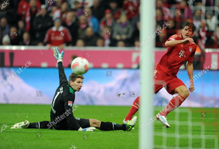 Munich's Mario Gomez (r) Scores the 5-0 Goal Against Hannover's Goalkeeper Ron-robert Zieler During the German Bundesliga Match Between Fc Bayern Munich and Hannover 96 at Allianz Arena in Munich Germany 24 November 2012 (attention: Embargo Conditions! the Dfl Permits the Further Utilisation of Up to 15 Pictures Only (no Sequntial Pictures Or Video-similar Series of Pictures Allowed) Via the Internet and Online Media During the Match (including Halftime) Taken From Inside the Stadium And/or Prior to the Start of the Match the Dfl Permits the Unrestricted Transmission of Digitised Recordings During the Match Exclusively For Internal Editorial Processing Only (e G Via Picture Picture Databases) Germany Munich