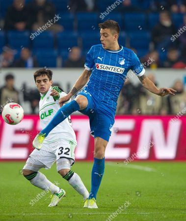 Wolfsburg's Fagner Conserva Lemos (l) Vies For the Ball with Hoffenheim's Joselu During the German Bundesliga Match Between Tsg 1899 Hoffenheim and Vfl Wolfsburg at Rhein-neckar-arena in Sinsheim Germany 18 November 2012 (attention: Embargo Conditions! the Dfl Permits the Further Utilisation of Up to 15 Pictures Only (no Sequntial Pictures Or Video-similar Series of Pictures Allowed) Via the Internet and Online Media During the Match (including Halftime) Taken From Inside the Stadium And/or Prior to the Start of the Match the Dfl Permits the Unrestricted Transmission of Digitised Recordings During the Match Exclusively For Internal Editorial Processing Only (e G Via Picture Databases) Germany Sinsheim
