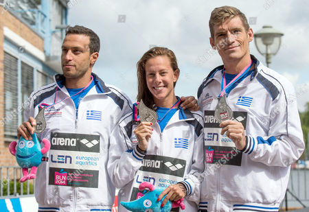 Spyridon Gianniotis (r) Kalliopi Araouzou (m) and Antonios Fokaidis From Greece Present Their Silver Medals of the Team Event 5km Open Water Finals at the 32nd Len European Swimming Championships 2014 at the Regattastrecke Gruenau in Berlin Germany 16 August 2014 Germany Berlin