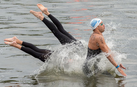 Antonios Fokaidis (right) Spyridon Gianniotis and Kalliopi Araouzou From Greece Are Starting in the Team Event 5km Open Water Finals at the 32nd Len European Swimming Championships 2014 at the Regattastrecke Gruenau in Berlin Germany 16 August 2014 Germany Berlin