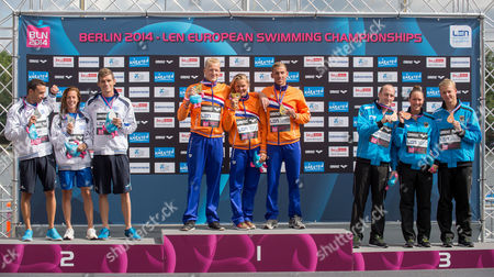 Second Placed Antonios Fokaidis (l-r) Kalliopi Araouzou and Spyridon Gianniotis From Greece First Placed Ferry Weertman Sharon Van Rouwendaal and Marcel Schouten From the Netherlands and Thord Placed Thomas Lurz Isabelle Haerle and Rob Muffels From Germany Present Their Medals of the Team Event 5km Open Water Finals at the 32nd Len European Swimming Championships 2014 at the Regattastrecke Gruenau in Berlin Germany 16 August 2014 Germany Berlin