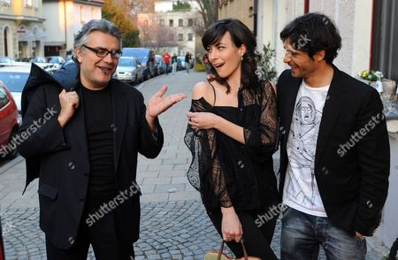 Italian Judge and Writer Giancarlo De Cataldo (l-r) Und Italian Actors Daniela Virgilio and Marco Bocci Arrive For the Mafia Movie Night 'Romanzo Criminale' at the Trattoria Seerose in Munich Germany 25 March 2012 the Tv Channel Sky Showed an Episode of the Italian Television Series 'Romanzo Criminale ' Which the Pay Channel Has Also in Its Regular Program As Part of the Munich Crime Fiction Festival Germany Munich