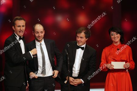 Hosts Charlotte Roche (r) Und Jan Boehmermann (l) Onstage As the Producers of Their Talk Show Philipp Kaessbohrer (2-l) and Matthias Schulz (2-r) Acknowledge Their Award During the German Television Awards Ceremony at the Coloneum in Cologne Germany 02 October 2012 Germany Cologne