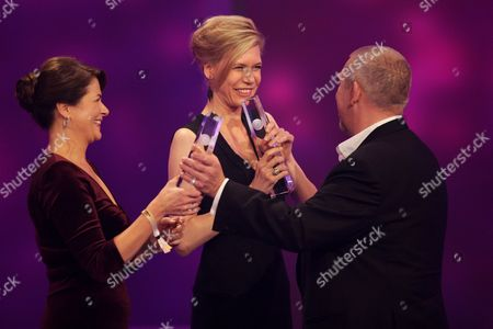 Actresses Barbara Auer (l) and Ina Weisse Receive the 'Best Actress' Award From Actor Dietmar Baer (r) Onstage During the German Television Awards Ceremony at the Coloneum in Cologne Germany 02 October 2012 Germany Cologne