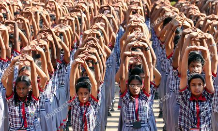 Students From the Kendriya Vidayalaya M E G & Centre School Conduct Relaxation Exercises Ahead of the Visit of German President Joachim Gauck (not Seen) in Bangalore India 08 February 2014 Gauck is in India on a Six-day State Visit India Bangalore