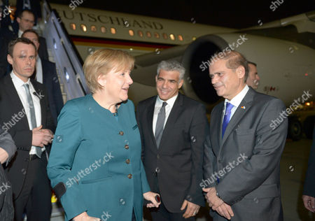 Israeli Ambassador to Germany Yakov Hadas-handelsman (r) Welcomes German Chancellor Angela Merkel (2-l) at the Airport in Tel Aviv Germany 24 February 2014 the German and Israeli Governments Will Meet For the Fifth German-israeli Government Consultations in Jerusalem on 24 and 25 February 2014 Israel Tel Aviv