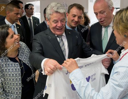 German President Joachim Gauck (c) Receives a T-shirt of the Social Project 'United at Work' Imprinted with His Name As the Head of the Project Former Prime Minister of Portugal Pedro Santana Lopes (2-r) Looks on at the 'Sao Pedro De Alcantara' Convent in Lisbon Portugal 25 June 2014 Joachim Gauck is on a Two-day Official Visit to Portugal Portugal Pamela