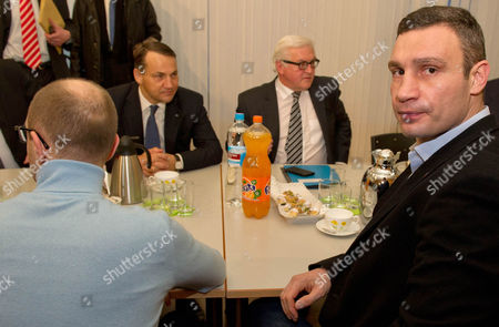 German Foreign Minister Frank-walter Steinmeier (back C-r) and Polish Foreign Minister Radoslaw Sikorski (back C-l) Attend a Meeting with Representatives of the Ukrainian Opposition Vitaly Klitschko (r) and Arseni Jazenjuk (l) in the Context of the Crisis Gripping the Country in Kiev Ukraine 20 February 2014 More Than 60 People Have Been Killed in Street Fighting in Kiev the Nationalist Svoboda Opposition Party Said Fresh Fighting Broke out Between Thousands of Protesters and Riot Police on Kiev's Independence Square Only Hours After Opposition Leaders and President Viktor Yanukovych Declared a Truce Ukraine Kiev