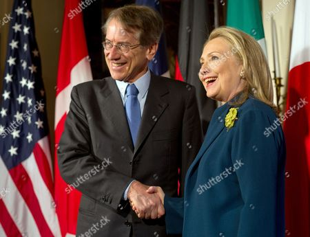Foreign Minister of Italy Giulio Terzi Di Sant Agata (l) is Greeted by Us Secretary of State Hillary Clinton at the Start of the G8 Meeting of Foreign Ministers in Washington Dc Usa 11 April 2012 the Foreign Ministers of the G8 Countries Discussed the State of the Middle East and North Korea United States Washington