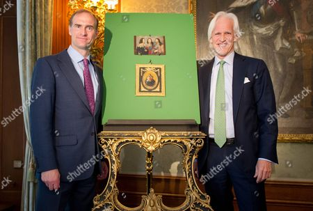 Stock Picture of Landgraf Heinrich Donatus Von Hessen (l) (lit Count Heinrich Donatus of Hesse) and Robert Edsel Founder of the 'Monuments Men Foundation For the Preservation of Art' Pose For Pictures at the Schlosshotel in Kronberg Germany 02 June 2015 They Are Standing Next to the Two Rediscovered Paintings Which Were Missing From Haus Schloss Friedrichshof Which Today is Schlosshotel Kronberg Both Paintings Belonged to the Collection of Empress Victoria (later Empress Friedrich) But Went Missing After the Second World War with the Help of a Family From the Usaáand the 'Monuments Men Foundation For the Preservation of Art' the Paintings Were Returned to Their Original Location the Current Schlosshotel Kronberg Germany Kronberg