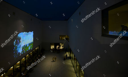 People Watch the New Video by Swiss Video Artist Pipilotti Rist in the Patio of the New Regional Museum For Arts and Culture in Muenster Germany 09 September 2014 Rist Created the Video 'Muensteranerin' For the Museum Germany Muenster