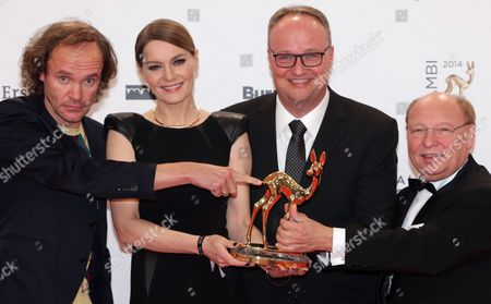 Team Members of 'Heute Show (lit:today Show)' L-r: Olaf Schubert Martina Hill Oliver Welke and Gernot Hassknecht Pose with Their Bambi Prize They Received in the Category 'Comedy' During the Bambi Awards Ceremony at the Stage Theater on Potsdamer Platz Ináberlin Germany 13 November 2014 the Bambi Prize Celebrates Its 66th Anniversary Germany Berlin
