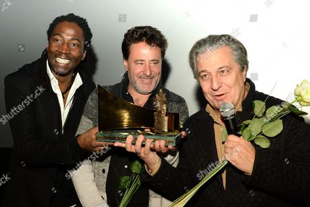 (l-r) French Actor Noom Diawara French Director Philippe De Chauveron and French Actor Christian Clavier Receive the 'Goldene Leinwand' (golden Screen) Award During a Ceremony at the 'Kulturbrauerei' (lit : Culture Brewery) in Berlin Germany 05 December 2014 They Received the Prize For Their Movie 'Qu'est-ce Qu'on a Fait Au Bon Dieu?' (serial (bad) Weddings) Germany Berlin