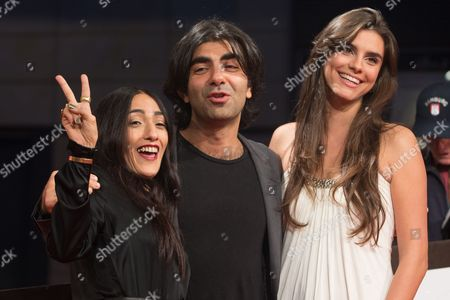 Stock Image of German Director Fatih Akin (c) Poses with French-moroccan Singer and Actress Hindi Zahra (l) and Actress Lara Heller During the Hamburg Film Festival in Hamburg Germany 27 August 2014 Fatih Akin Won Received the Douglas-sirk-prize During the Ceremony Germany Hamburg