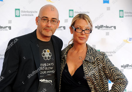 Stock Picture of Canadian Actress and Director Deborah Kara Unger (r) Poses with Festivall Director Torsten Neumann (l) on the Red Carpet of the 21st Oldenburg International Filmfest in Oldenburg Germany 10 September 2014 the Festival Runs From 10 to 14 September Germany Oldenburg