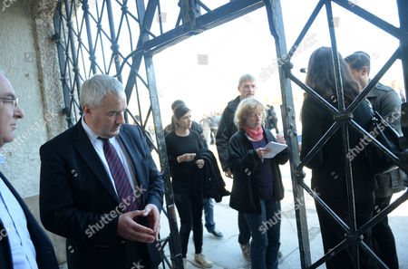 Bavarian Minister of Culture Ludwig Spaenle Looks at where the Part of the Gate Bearing the Nazi Slogan 'Arbeit Macht Frei' (lit : 'Work Sets You Free') was Stolen From the Former Concentration Camp in Dachau Germany 03 November 2014 Police Were Investigating the Theft of the Historic Main Gate of the Nazi-era Dachau Concentration Camp Bearing the Nazi Slogan 'Arbeit Macht Frei' (work Sets You Free) the Theft was Condemned by the Head of the Memorial at Auschwitz-birkenau in Nazi-occupied Poland Which was Also Vandalized Five Years Back when a Gate with a Similar Slogan was Stolen by Swedish Neo-nazis Germany Munich