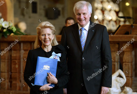 Bavarian Prime Minister Horstáseehofer (r) Awards the Bavarian Order of Merit to Austrian Actress Christiane Hoerbiger (l) at Municháresidenz City Palace in Munich Germany 17 December 2014 Germany Munich