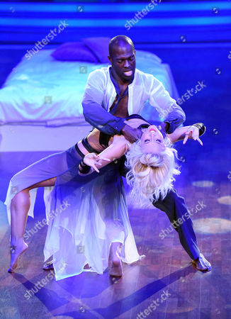 A Picture Made Available on 23 May 2015 Shows Ghanaian-born German Former Soccer Player Hans Sarpei (back) and Austrian Professional Dancer Kathrin Menzinger Performing During the Rtl Television Program 'Let's Dance' German Version of 'Dancing with the Stars' in Cologne Germany 22 May 2015 Germany Cologne