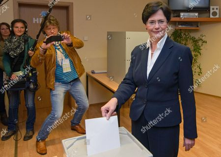Members of the Media Watch Christine Lieberknecht (r) Governor of the German Thuringia State and Top Candidate of Her Christian Democratic Union (cdu) Party Casting Her Vote in the Legislative State Elections at a Polling Station in Ramsla Germany 14 September 2014 Two of Germany's 16 States Went to the Polls in Legislative Elections where Chancellor Angela Merkel's Cdu Party Runs a Risk of Being Upstaged by a Late Surge From Two Fringe Parties Surveys Before Polling Day Suggested Merkel's Will Be the Highest Scoring Party in Thuringia in Germany's Central Hills While the Social Democratic Party (spd) Her Federal Coalition Partner Will Top the Vote in Brandenburg a Rural State Surrounding the Capital Berlin Germany Ramsla