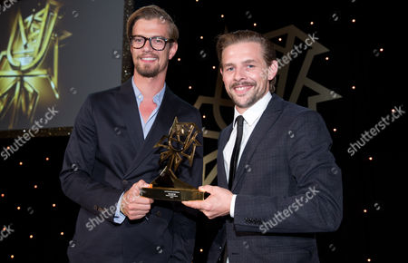 Presenters Joko Winterscheidt (l) and Klaas Heufer-umlauf Smile As They Pose with the 'Best Entertainment' Award During the 53rd Rose D'or Awards at Hoteláadlon in Berlin Germany 17 September 2014 Germany Berlin