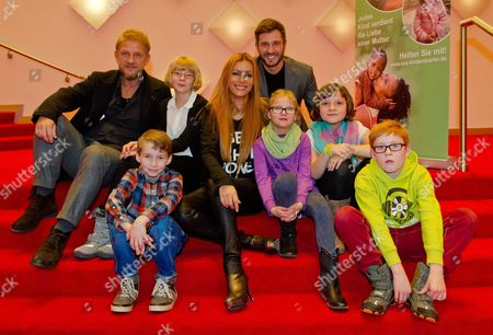Director Soenke Wortmann (l-r) Actress Yasmina Filali and Actor and Host Jochen Schropp Pose with Children From the Sosáchildren's Village Harksheide Before the Benefit Premiere of the Musical 'The Miracle of Bern' in Hamburg Germany 15 November 2014 Germany Hamburg