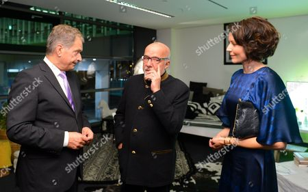 Finnish President Sauli Niinisto (l) and His Wife Jenni Haukio (r) Listen to Brazilian Writer Paulo Coelho (c) Prior to the Opening Ceremony of the Frankfurt Bookáfair 2014 in Frankfurt Am Main ágermany 07áoctober 2014 the Guest of Honor This Year is Finland the World's Largest Book Fair Will Run Until 12 October Germany Frankfurt Am Main
