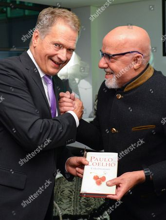 Finnish President Sauli Niinisto (l) Speaks with Brazilian Writer Paulo Coelho (r) Prior to the Opening Ceremony of the Frankfurt Bookáfair 2014 in Frankfurt Am Main ágermany 07áoctober 2014 the Guest of Honor This Year is Finland the World's Largest Book Fair Will Run Until 12 October Germany Frankfurt Am Main