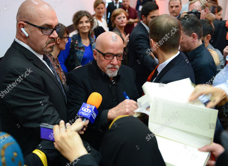 Brazilian Author Paulo Coelho (c) Signs Autographs at the Frankfurt Book Fair Ináfrankurt Germany 08 October 2014 the World's Largest Book Fair Continues Until 12 October Finland is This Year's Host Country Germany Frankfurt Am Main