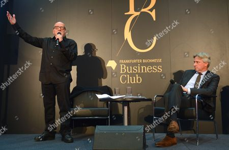 Brazilian Author Paulo Coelho (l) Speaks Next to Book Fair Director Juergen Boos at an Event For the Future of Reading at the Frankfurt Book Fair Ináfrankurt Germany 08 October 2014 the World's Largest Book Fair Continues Until 12 October Finland is This Year's Host Country Germany Frankfurt Am Main