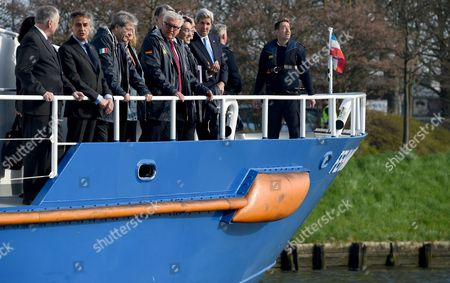 Participants of the G7 Foreign Ministers' Meeting Ride a Coastal Guard Ship Crossing the River Trave to Get to the Conference Venue Ináluebeck ágermany 15 April 2015 (l-r) Canada's Foreign Minister Rob Nicholson Luebeck Mayor Bernd Saxe Italy's Foreign Minister Paolo Gentiloni European Union High Representative For Foreign Affairs and Security Policy Federica Mogherini German Foreign Minister Frank-walter Steinmeier (spd) British Secretary of State For Foreign and Commonwealth Affairs Philip Hammond Japan's Foreign Minister Fumio Kishida French Foreign Minister Laurent Fabius and Usásecretary of State John Kerry Germany Luebeck