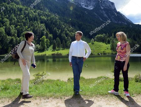Stock Photo of (l-r) Akie Abe Wife of Japanese Prime Minister Shinzo Abe Joachim Sauer the Husband of German Chancellor Angela Merkel and Laureen Harper Wife of the Canadian Prime Minister Stephen Harper Share a Light Moment As They Walk Through the Countryside Near Ferchensee Lake Close to Elmau Castle in Garmisch-partenkirchen Germany 07 June 2015 Leaders From the United States Britain France Germany Italy Canada and Japan - the Seven Leading Industrialized Nations (g7) - Meet to Discuss the Global Economy As Well As Foreign Security and Development Policy at Elmau Castle Bavaria on 07 and 08 June As the Climax of Germany's Presidency of the G7 Germany Garmisch-partenkirchen