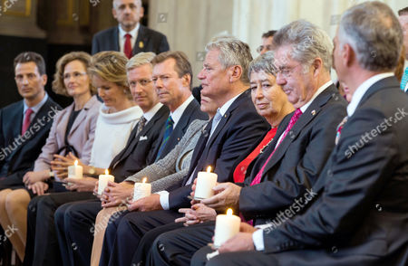 German President Joachim Gauck (c) is Flanked by Belgium's King Philippe (4-l) and Queen Mathilde (3-l) Grand Duke Henri of Luxemburg (5-l) Crown Prince Alois Von Und Zu Liechtenstein (l) with Princess Sophie (2-l) Austrian President Heinz Fischer (2-r) with His Wife Margit (3-r) and Swiss President Didier Burkhalter (r) and Others As They Hold Burning Candels While Attending a Ceremony in the Saint Mary's Church at the End of the 11th Meeting of the German-speaking Heads of State in Rostock Germany 18áseptember 2014 They Are Discussing Questions About Democratic Change and Remembering the Peaceful Revolution in East Germany 25 Years Ago at the Informal Meeting Germany Rostock