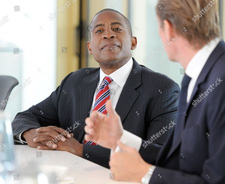 Us Journalist and Businessman Carlos Watson (l) the Founder of the Online Magazine Ozy Com and Mathias Doepfner Chairman of Axel Springer Se Talk During a Meeting in Berlin Germany 06 October 2014 Axel Springer is Investing 20 Million Us Dollars in the Us Website Germany Berlin