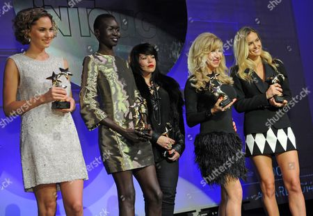 The Laureates (l-r) Us Model and Actress Emma Ferrer (shooting Model International) South Sudanese-british Model Alek Wek (style International) British Singer-songwriter Alex Hepburn (music International) German Carmen Geiss (tv Personality 2014) and Israeli Model Bar Refaeli (model International) Pose After Being Awarded with the Intouch Award 2014 in Duesseldorf Germany 23 October 2014 the International Intouch Magazine Awarded Celebrities in Five Different Categories in the Second Year Germany Duesseldorf