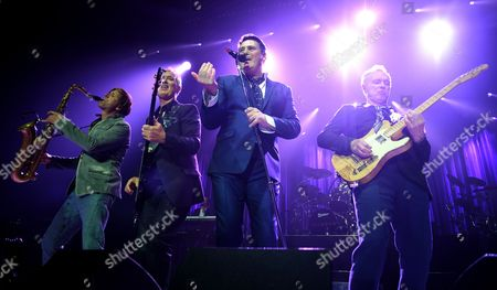 (l-r) British Saxophonist Steve Norman Bassist Martin Kemp Singer Tony Hadley and Gary Kemp of the Band Spandau Ballet Perform Onstage During Their Concert at the Tempodrom in Berlin Germany 20 April 2015 Germany Berlin