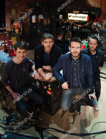 Stock Photo of Members of the Band Revolverheld Jakob Sinn (l-r) Chris Rodriguez Johannes Strate and Kristoffer Huenecke Pose on Stage in Front of the Mtváunplugged Setting in the Friedrich Ebert Hall in Hamburg Germany 08 April 2015 the Performance Will Be Broadcasted in Autumn 2015 Germany Hamburg
