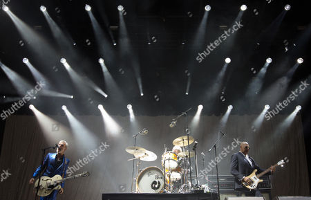 Stock Image of (l-r) Singer and Guitarist Ruben Block Drummer Mario Goossens and Bassist Paul Van Bruystegem of Belgian Rock Band Triggerfinger Perform on Stage During the 'Rock Im Revier' Music Festival at the Veltins-arena in Gelsenkirchen Germany 30 May 2015 the Event Runs From 29 to 31 May Germany Gelsenkirchen