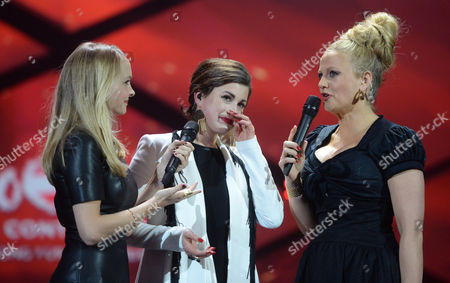 Stock Image of German Singer Ann Sophie (c) Reacts with Presenter Barbara Schoeneberg (r) and Janin Reinhardt (l) During the German National Final 'Our Song For Austria' to Represent Germany at the Eurovision Song Contest 2015 in Hannover (lower Saxony) Germany 05 March 2015 Ann Sophie Will Sing For Germany During the 60th Annual Eurovision Song Contest Will Take Place in Vienna in May Germany Hannover
