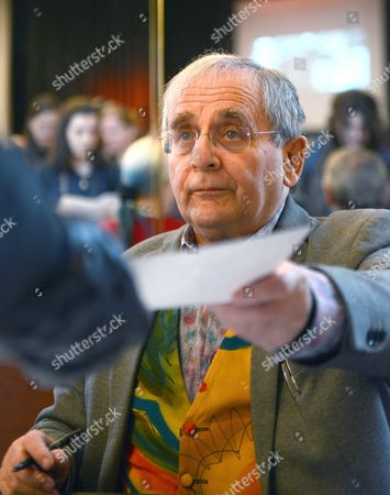 Scottish Actor Sylvester Mccoy who Plays Radagast in Peter Jackson's Three-part Adaptation of J R R Tolkien's 'The Hobbit' Signs Autographs to Fans During the Third Day of the Hobbit Convention 'Hobbitcon 3' in Bonn Germany 06 April 2015 About 5 000 Fans From All Over the World Visited the Three-day Fantaasy Convention Which Took Place at the Maritim Hotel in Bonn Until Easter Monday 06 April Germany Bonn