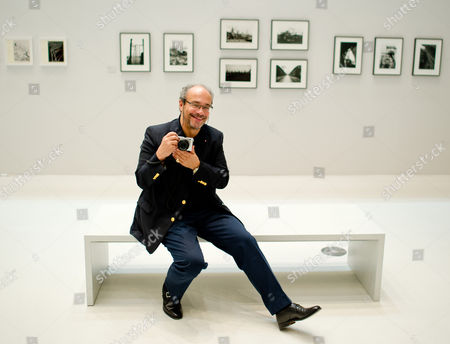 Chairman of the Supervisory Board of Leica Andreas Kaufmann Poses at the Exhibition 'Eyes Wide Open! 100 Years of Leica Photography' at the House of Photography at Deichtorhallen Art Center in Hamburg Germany 23 October 2014 the Exhibition Feature Aboute 550 Photographs by More Than 140 Artists and Will Run Until 11 January 2015 Germany Hamburg