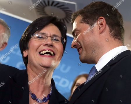 Christian Democrats (cdu) Top Candidate and Incumbet Thuringian Prime Minister Christine Lieberknecht (l) Reacts to the First Predictions of the State Election in Erfurt Germany 14 September 2014 a Newcomer Party That Opposes Euro Bailouts the Alternative For Germany (afd) Won More Than 10 Cent of the Votes in Two German State Elections Television Exit Polls Said Chancellor Angela Merkel's Christian Democratic Union (cdu) was the Victor in the Central State of Thuringia with 34 Per Cent of Votes Ard Television Said As Official Vote Counting Began Germany Erfurt