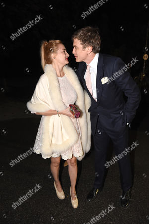 Princess Maria Theresia of Thurn and Taxis (l) and Her Fiance Hugo Wilson (r) Arrive For Their 'Wedding Shower' Party at P1 Nightclub in Munich Germany 12 September 2014 Princess Maria Theresia Will Marry Hugo Wilson on 13 September at Lake Starnberg in Tutzing Germany Germany Munich