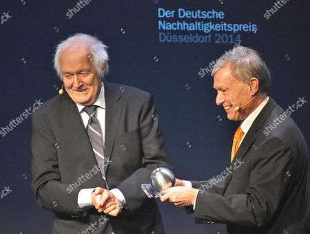 Swedish Author Henning Mankell (l) Applauds Former German President Horst Koehler (r) For Receiving the Honory Prize During the Awarding Ceremony of the 'Deutscher Nachhaltigkeitspreis' (german Sustainability Award) in Duessledorf Germany 28 November 2014 the Award Honours Germany's Most Sustainable Companies and Building Projects Germany Duesseldorf