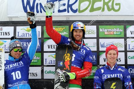 (l-r) Benjamin Karl of Austria (2nd Place) Roland Fischnaller of Italy (1st Place) and Konstantin Shipilov of Russia (3rd Place) Celebrate on the Podium at the Men's Parallel Slalom at the Snowboard World Cup in Winterberg Germany 14 March 2015 Germany Winterberg