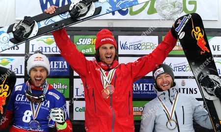 (l-r) Roland Fischnaller of Italy (word Ranking Place 2) Zan Kosir of Slovenia (world Ranking Place 1) and Justin Reiter of the Usa (world Ranking Place 3) Celebrate Their World Ranking Positions at the Men's Parallel Slalom at the Snowboard World Cup Ináwinterberg Germany 14 March 2015 Germany Winterberg