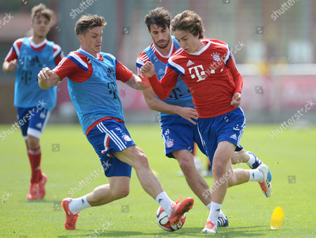 (l-r) Tobias Schweinsteiger Javi Martinez and Gianluca Gaudino Compete For the Ball During a Training Session of the German Bundesliga Soccer Club Fcábayern Munich in Munich Germany 29 April 2015 Germany Munich