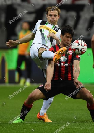 Frankfurt's Nelson Valdez (r) in Action Against Moenchengladbach's Tony Jantschke During the German Bundesliga Soccer Match Between Eintracht Frankfurt and Borussia Moenchengladbach at the Commerzbank Arena in Frankfurt Am Main Germany 17 April 2015 (embargo Conditions - Attention: Due to the Accreditation Guidelines the Dfl Only Permits the Publication and Utilisation of Up to 15 Pictures Per Match on the Internet and in Online Media During the Match ) Germany Frankfurt/main