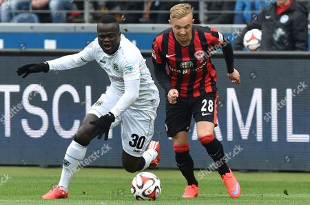Stock Image of Hannover's Didier Ya Konan (l) and Frankfurt's Sonny Kittel Compete For the Ball During the German Bundesliga Soccer Match Between Eintracht Frankfurt and Hannover 96 at the Commerzbank-arena in Frankfurt Am Main Germany 4 April 2015 (embargo Conditions - Attention: Due to the Accreditation Guidelines the Dfl Only Permits the Publication and Utilisation of Up to 15 Pictures Per Match on the Internet and in Online Media During the Match ) Epa/boris Roessler Epa/boris Roessler Germany Frankfurt/main